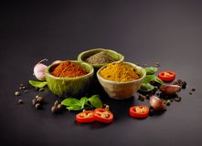 Various spices on black background Stock Photo