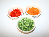 Bowls of Vegetables. Three bowls of chopped carrots, broccoli, and red pepper Royalty Free Stock Photos