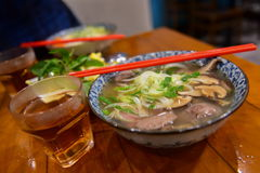 Bowls of Vietnamese pho noodle soup. Topped with beef Stock Photo