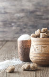 Bowls of white and brown sugar on the wooden background Royalty Free Stock Photo
