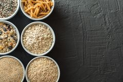 Bowls with whole grain carbohydrates, oats, brown rice, seeds, quinoa and whole grain pasta. Whole grain cereals. Bowls with whole grain carbohydrates, oats Stock Photos