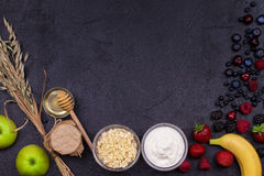 Bowls of Yogurt and Oat Flakes, Fresh Apples, Honey and Summer Berries Stock Photos