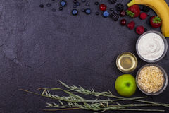 Bowls of Yogurt and Oat Flakes, Fresh Apples, Honey and Summer Berries Royalty Free Stock Photos
