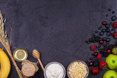Bowls of Yogurt and Oat Flakes, Fresh Apples, Honey and Summer Berries Royalty Free Stock Photo