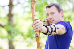 Bowman aiming arrow at target Royalty Free Stock Images
