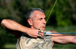 Bowman aiming with bow and arrow Royalty Free Stock Photography