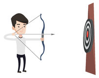 Bowman aiming with bow and arrow at the target. Stock Image