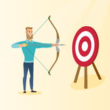 Bowman aiming with a bow and arrow at the target. Royalty Free Stock Photos