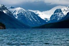 Bowman Lake, Glacier National Park. Beautiful mountain lake in Montana nestled below snowy mountains Royalty Free Stock Image