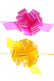 Bows. Yellow and pink bows isolated on white background Royalty Free Stock Photos