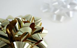 Bows. A gold bow and a white background bow on white Stock Images