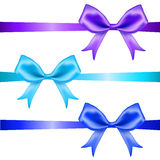 Bows. Blue glossy ribbons. Stock Images