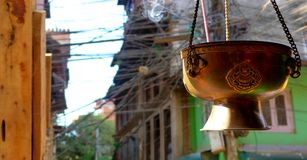 Incense and electric wires in Nepal royalty free stock photo