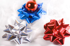 Bows on feather. Ornament and Bows on feather - Christmas Background Royalty Free Stock Image