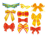 Bows with golden, red and blue ribbons Royalty Free Stock Photo