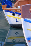 Bows of Greek fishing boats royalty free stock images