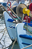 Bows of a greek fishing boats in a harbor at morning Royalty Free Stock Image