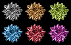 bows made of multicolored shiny ribbons Royalty Free Stock Images