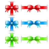 Bows with ribbons on white in red green and blue colors Stock Photography