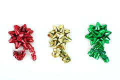 Bows In A Row. Red, gold and green bows on a white background Stock Photo