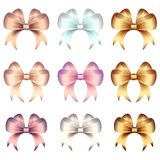 Bows of satin and silk ribbons with hearts and gold ornaments decoration Royalty Free Stock Photos