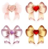 Bows of satin and silk ribbons with hearts and gold ornaments decoration Stock Image