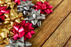 Bows of three colors for gifts. Bows for gifts of three colors over wooden table Stock Photo