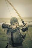 Bows woman / medieval armor / retro split toned royalty free stock photos