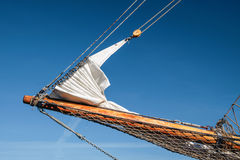 Bowsprit and gathered sail of a large sailing ship Royalty Free Stock Image