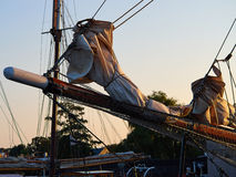 Bowsprit and gathered sail of a large sailing ship Stock Images