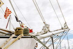 Bowsprit and rope coiled up of the sailing ship. Royalty Free Stock Images