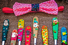 Bowtie and cheerfully decorated spoons for children Stock Photo