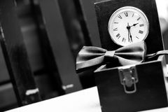 Bowtie and clock Stock Images