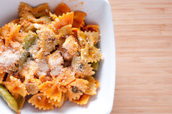 Bowtie pasta with chicken, fresh tomatoes in a creamy but hea Stock Image