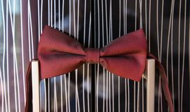 Bowtie tux. Red bowtie groom on on the wardrobe doors Stock Images