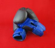 Box. Blue boxing gloves on the red background stock photo