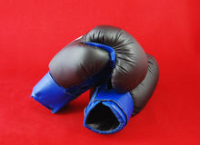 Box. Blue boxing gloves on the red background royalty free stock photos