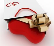 Box as heart form with a gold bow in a bag for a gift. The concept of a gift with love Royalty Free Stock Photos
