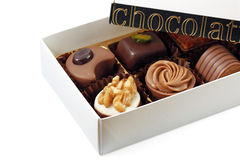 Box of assorted chocolates. On white background Royalty Free Stock Photo