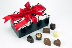 Box with assorted chocolates. Chocolate box with red ribbon and assorted chocolates Royalty Free Stock Photo