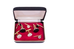 Box with assorted cuff links. Isolated Royalty Free Stock Images