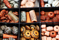 Box of Beads. A box of numerous beads in a traditional African style Stock Photography