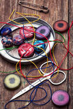 Box of beads for needlework on wooden table royalty free stock photography