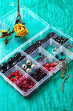 Box of beads for needlework on wooden table Royalty Free Stock Photos
