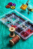 Box with beads and thread Stock Photography