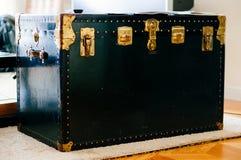 Box. A big black box with golden locks stock photography