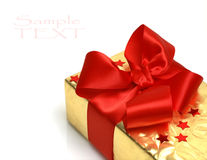 Box with big red holiday bow Royalty Free Stock Images
