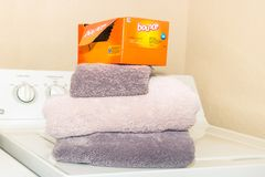 A box of Bounce dryer sheets is placed on clean folded towels - side angle view royalty free stock image