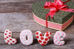 Box with a bow in the form of heart and inscription love Royalty Free Stock Photo