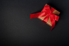 Box, bow and ribbon on dark background Stock Image